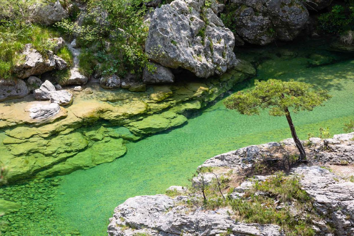 Top wild swimming holes and water slides in Italy
